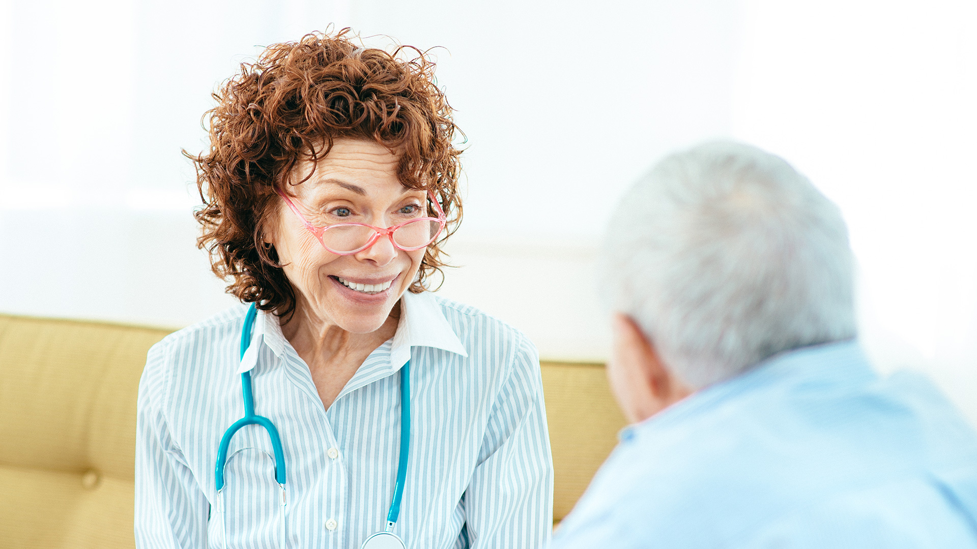 Female provider talking to male patient